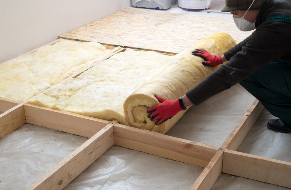Person insulating home to prevent dampness